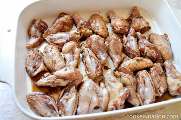 Place marinated chicken into greased pan.