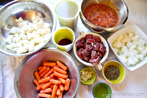 Gather your ingredients. Peel and dice the potatoes, onions and carrots into bite sized pieces.