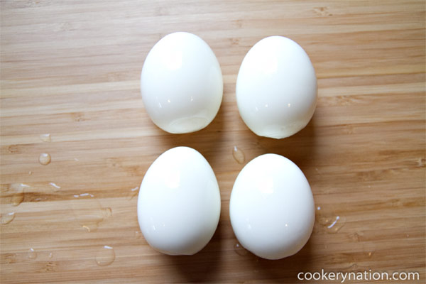 Refrigerate the eggs or peel them and serve.